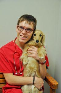 Team member Tanner Tilton with the office dog Gus